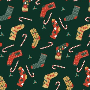 Christmas socks and Candies on dark green