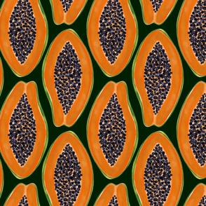 Papaya on black. Exotic orange fruit