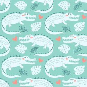 Cute crocodiles on mint background