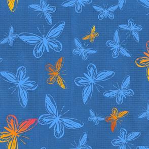 Orange and Blue Butterflies in Flight