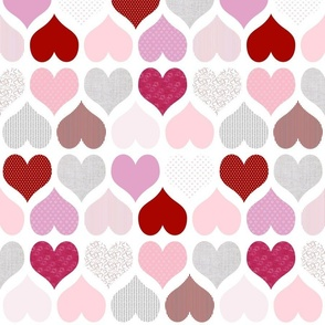 Pink and red hearts on white