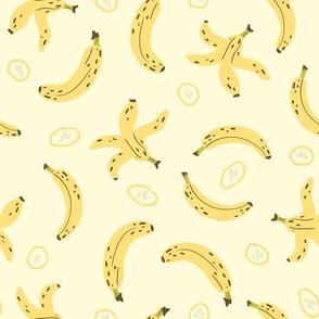 Banana, peel and slices on yellow