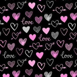 pink and gray hearts on a black background