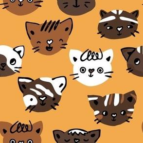 Cute cats heads fun animal seamless pattern