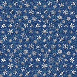 Christmas themed snowflakes on teal blue snowstorm