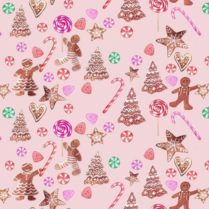 Christmas candy and gingerbread people on pink