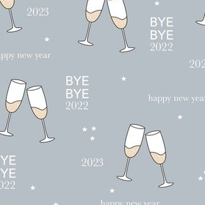 Have a drink - Happy new year celebration champagne bubbles toast soft stone blue gray night stars typography