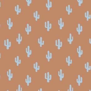 The minimalist boho garden cactus plants desert pattern baby neutral nursery caramel copper brown baby blue