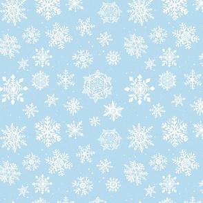Small Light blue winter snowflakes snow