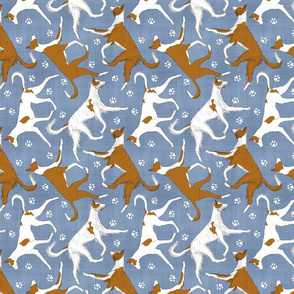 Trotting Ibizan hounds and paw prints - faux denim