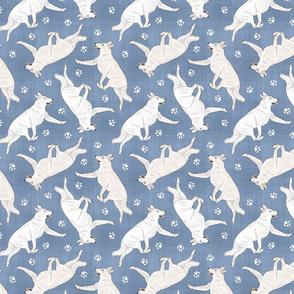 Trotting White Shepherd dogs and paw prints - faux denim