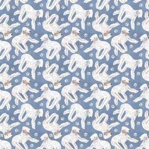 Trotting Bedlington Terriers and paw prints - faux denim