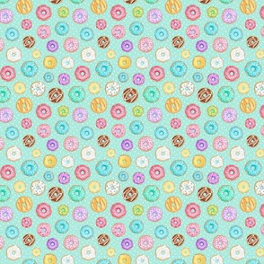 Scattered Rainbow Donuts on mint spotty - tiny scale