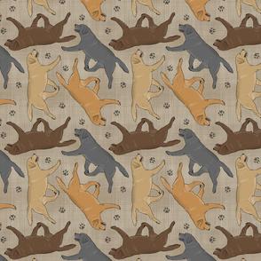 Trotting Labrador Retrievers and paw prints - faux linen