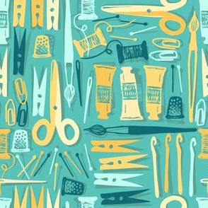 Sewing and painting tools on jade green