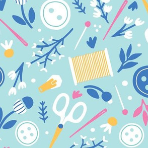 Sewing Florals with craft supplies, buttons, scissors, thread and needle