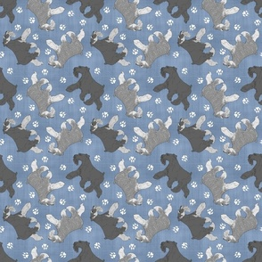 Trotting uncropped Miniature Schnauzers and paw prints - faux denim