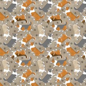 Trotting tailed Pembroke Welsh Corgis and paw prints - faux linen