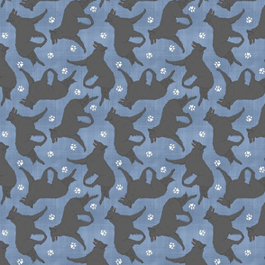 Trotting Belgian Sheepdog and paw prints - faux denim