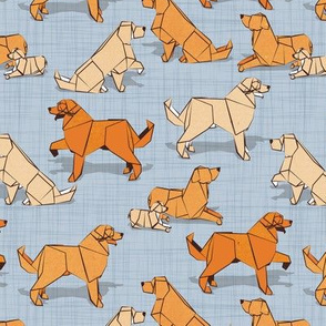 Small scale // Origami Golden Retriever and Labrador friends // pastel blue linen texture background orange and beige paper and cardboard dogs