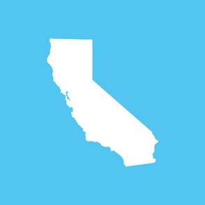 """California silhouette, 15x12"""" in 18"""" block, white on bright blue sky"""