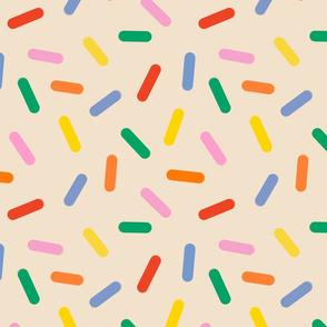 rainbow sprinkles on butter cream