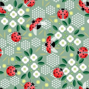 ladybugs and flowers on green