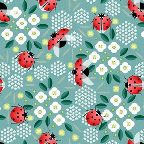 ladybugs and flowers on blue