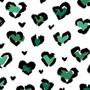 Little St Patrick's Day hearts leopard design messy animal print boho nursery trend green on white