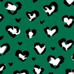 Little St Patrick's Day hearts leopard design messy animal print boho nursery trend white black on green