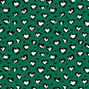 Little St Patrick's Day hearts leopard design messy animal print boho nursery trend white black on green SMALL