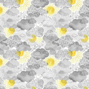 The sun shines above the clouds - yellow and gray