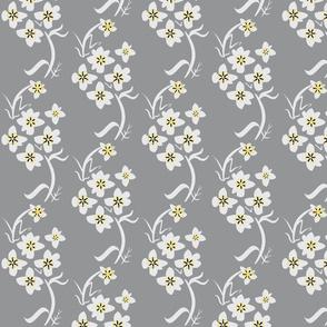 Sprig of tiny flowers/grey