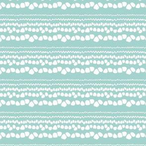 White pebbles over blue