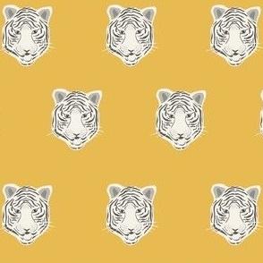white tiger on yellow