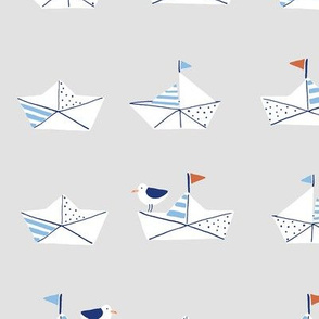 Paper boats in gray