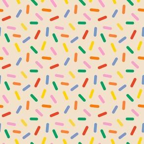 rainbow sprinkles on butter cream - half size