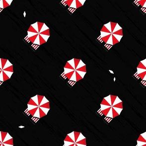 Black beach umbrellas