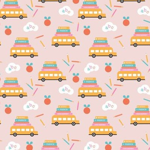Piles of books and school busses and pencils back to school teacher design soft pink peach blue yellow