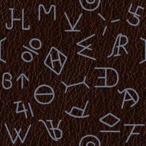 Slate Brands on dark leather