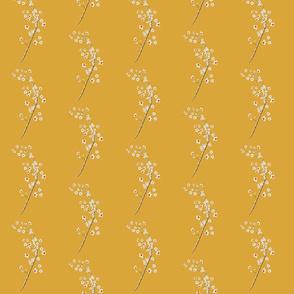 Blossom sprigs on mustard