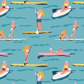 Paddle boarding girls