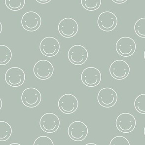Smiley faces positive vibes little smile circular boho design neutral earthy tones nursery design moody mint green