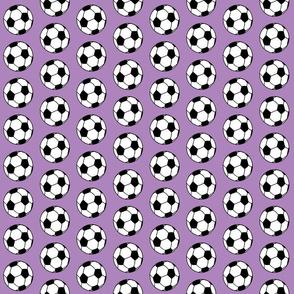 Soccer balls on purple