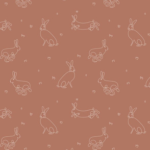 rabbits outlines on brown