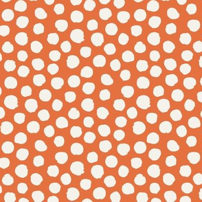 Orange with off white spots
