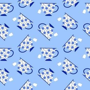 Porcelain Teacups on Blue