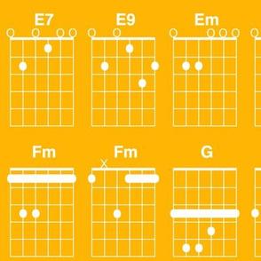 guitar chords - white on saffron yellow