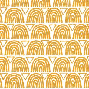 mustard yellow rainbows and traingles on white