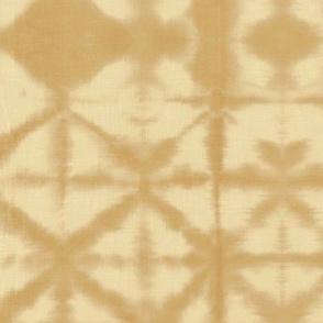 The minimalist boho shibori tie dye paint technique texture baby neutral ochre yellow